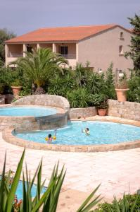 The swimming pool at or near Résidence Benista