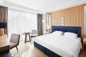 A bed or beds in a room at Grand Hyatt Athens