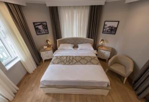 מיטה או מיטות בחדר ב-Boutique Hotel Khokhobi Old Tbilisi