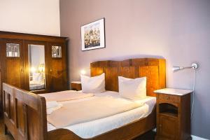 Un ou plusieurs lits dans un hébergement de l'établissement Pension Peters – Das andere Hotel