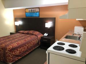 A kitchen or kitchenette at Royal Windsor Motel