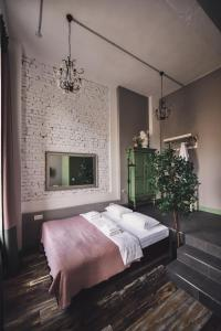 A bed or beds in a room at Fabrika Hotel