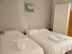 A bed or beds in a room at Flor do Cacau