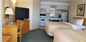 A television and/or entertainment centre at Athabasca Lodge Motel