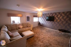 A seating area at Om Ormskirk apartment.