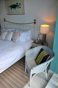 A bed or beds in a room at Lulworth Cove Inn
