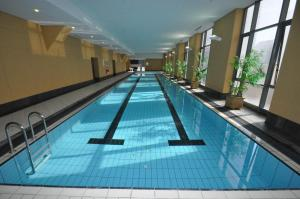 The swimming pool at or near Sydney CBD Self Contained Modern Studio Apartments (PITT)
