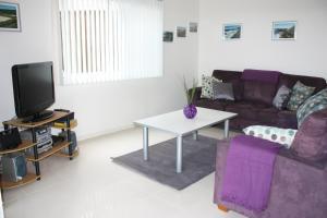 A seating area at Blueys Apartment @ 192 Boomerang Drive