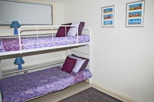 A bunk bed or bunk beds in a room at Blueys Apartment @ 192 Boomerang Drive