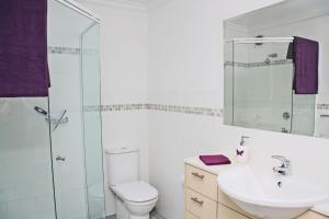 A bathroom at Blueys Apartment @ 192 Boomerang Drive