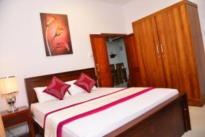 A bed or beds in a room at Sunshine Greens