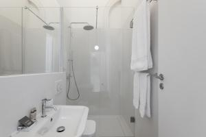 A bathroom at The White Box Boutique House