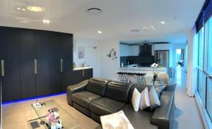 A seating area at Glasshouse Apartment - at Parramatta