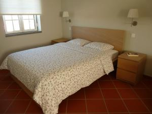 A bed or beds in a room at MirArte