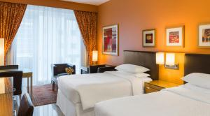A bed or beds in a room at Four Points by Sheraton Downtown Dubai