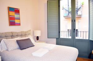 Un ou plusieurs lits dans un hébergement de l'établissement Barcelona Mercaders Apartments
