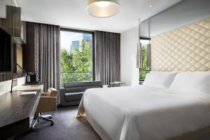 A bed or beds in a room at Excelsior Hotel Gallia - Luxury Collection Hotel