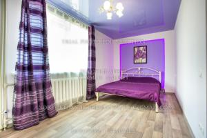 A bed or beds in a room at Apartment Perekopska st.