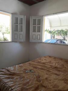 A bed or beds in a room at ilha de itamaraca pernambuco