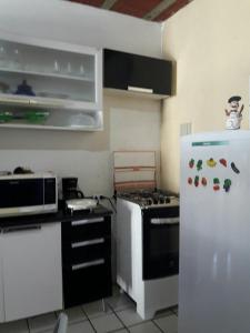 A kitchen or kitchenette at ilha de itamaraca pernambuco