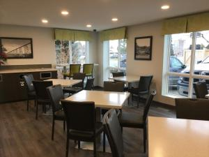 A restaurant or other place to eat at Super 8 by Wyndham Lethbridge