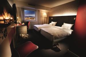A bed or beds in a room at pentahotel Reading