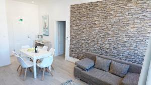 A seating area at Apartments Budin Rijeka City Center