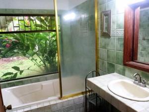 A bathroom at House of the Rising Wave (Casa Ola Creciente)