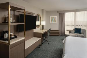 A television and/or entertainment center at Sheraton Dallas Hotel by the Galleria