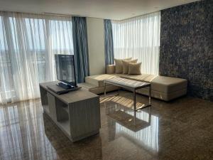 A seating area at Hotel Daun Bali Seminyak