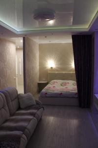 A bed or beds in a room at Design Studio on Solnechny Bulvar 8