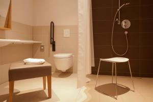 Ein Badezimmer in der Unterkunft Gasthof Zufriedenheit
