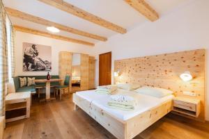 Кровать или кровати в номере Haus Mühlbacher