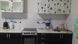 Кухня или мини-кухня в Apartment Your welcome