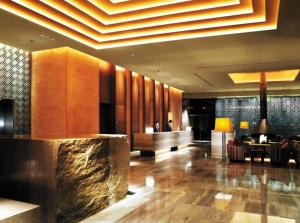 The lobby or reception area at Ramada Plaza by Wyndham Gwangju