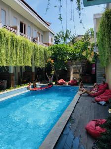 The swimming pool at or near Mojosurf Camp Canggu