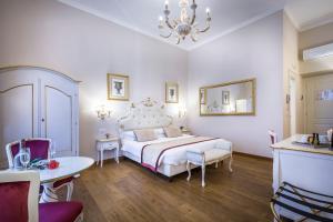A bed or beds in a room at B&B La Terrazza Sul Duomo