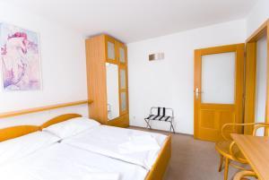 Кровать или кровати в номере Hotel Smaragd