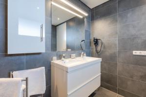 Een badkamer bij De Berkenhof Aparthotel