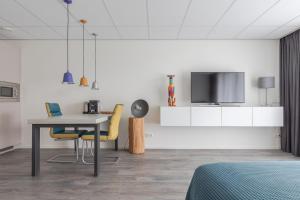 Een TV en/of entertainmentcenter bij De Berkenhof Aparthotel