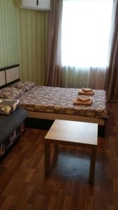 A bed or beds in a room at апартамент