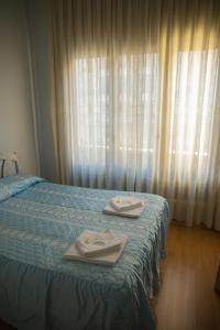 Posteľ alebo postele v izbe v ubytovaní Hostal Lamalonga