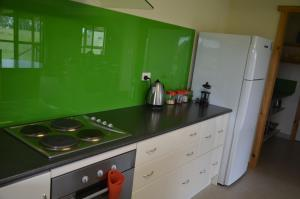 A kitchen or kitchenette at Peace at Paradise