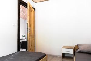 Łóżko lub łóżka w pokoju w obiekcie Tarasy nad Solina