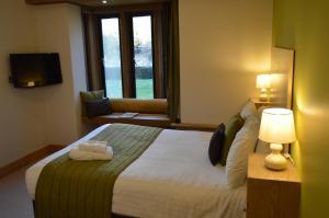 Cama o camas de una habitación en Canterbury Cathedral Lodge