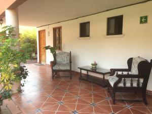 Zona de estar de Hotel Ollin Teotl