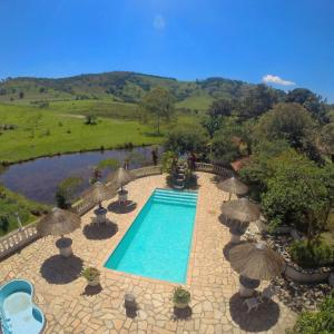 A view of the pool at Hotel Fazenda dos Anjos or nearby