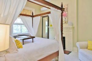 A bed or beds in a room at All Suites Whitney Manor