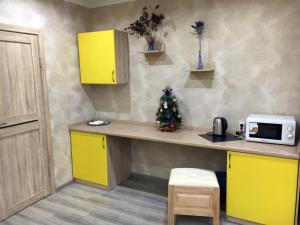A kitchen or kitchenette at Erzi club Hotel