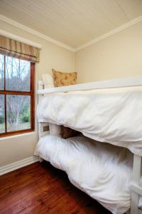 A bunk bed or bunk beds in a room at Hogsback Arminel Hotel